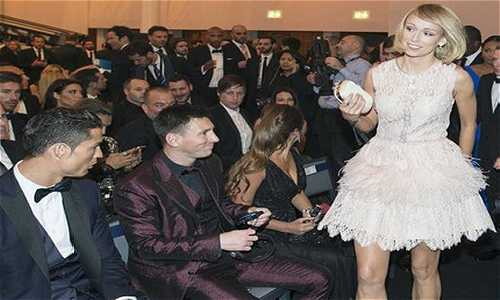 Stephanie Roche with Messi and Ronaldo