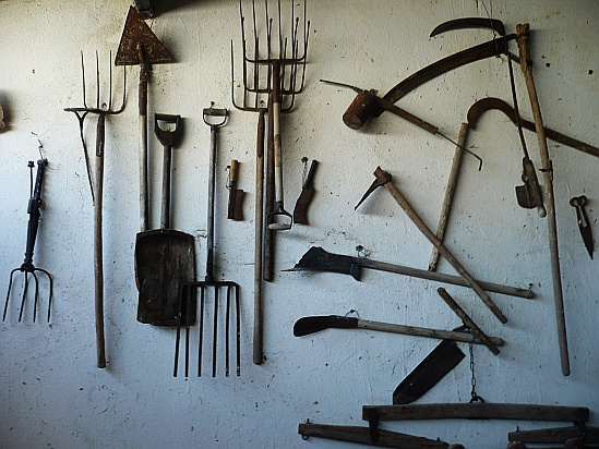 Farm tools on wall - Public Domain Photograph